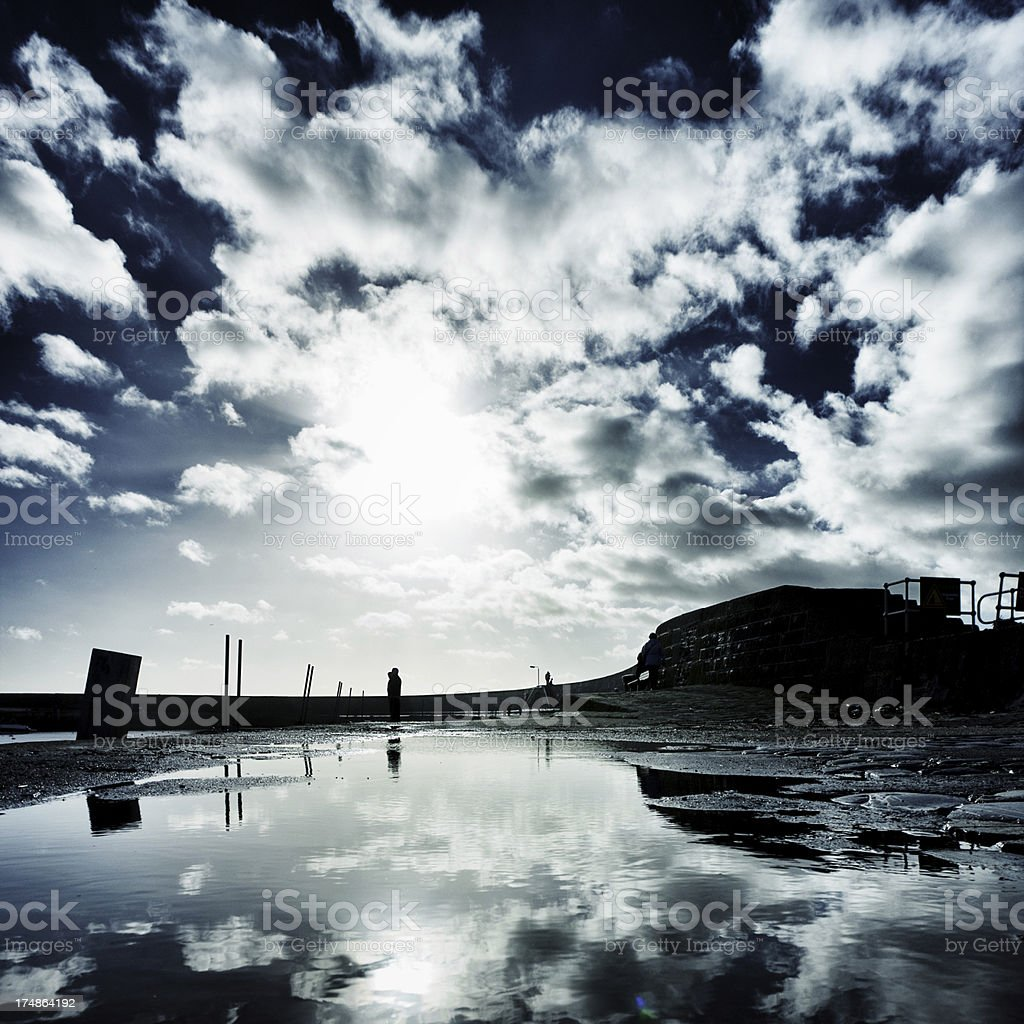 Dramatic sky at The Cobb royalty-free stock photo
