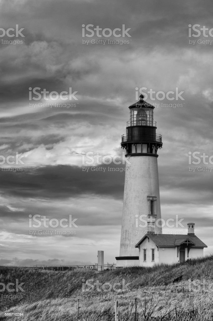 Dramatic sky behind picturesque lighthouse stock photo