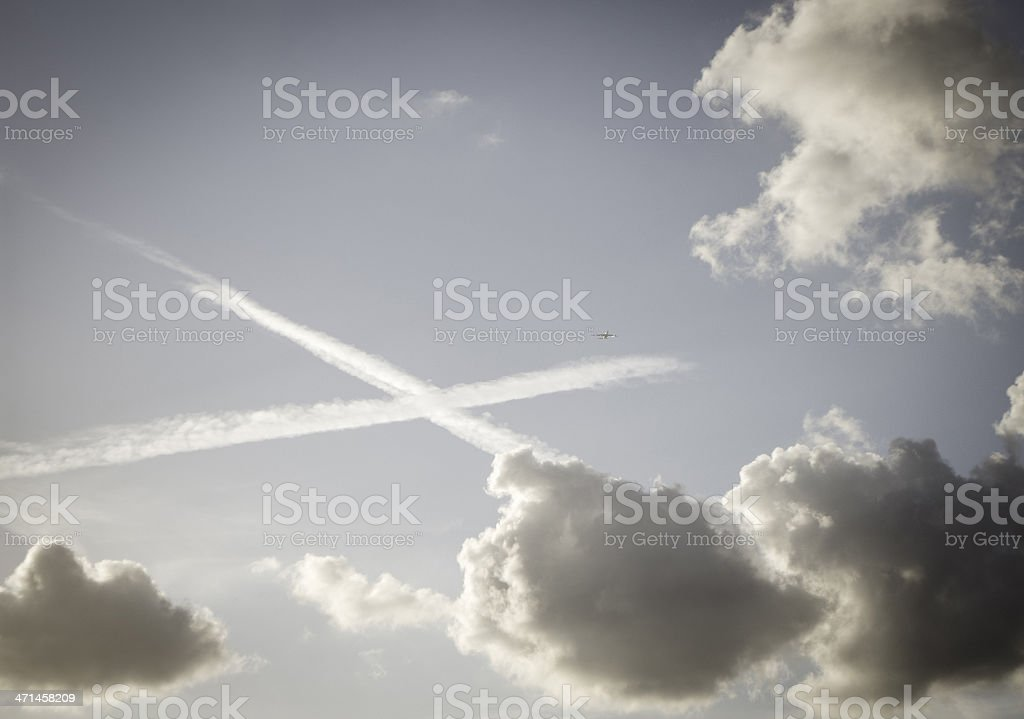 dramatic sky chemtrails vapour trails and clouds stock photo