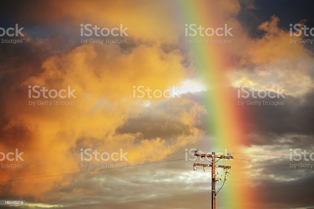 Dramatic sky, high voltage power line and rainbow royalty-free stock photo