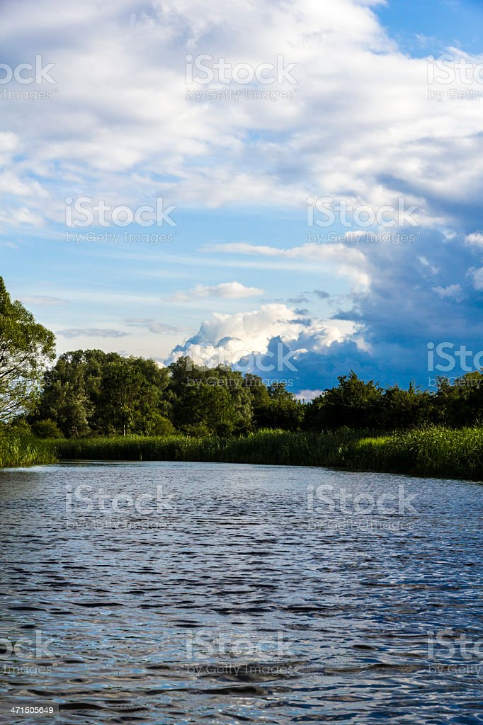 dramatic sky on a lake in summer stock photo