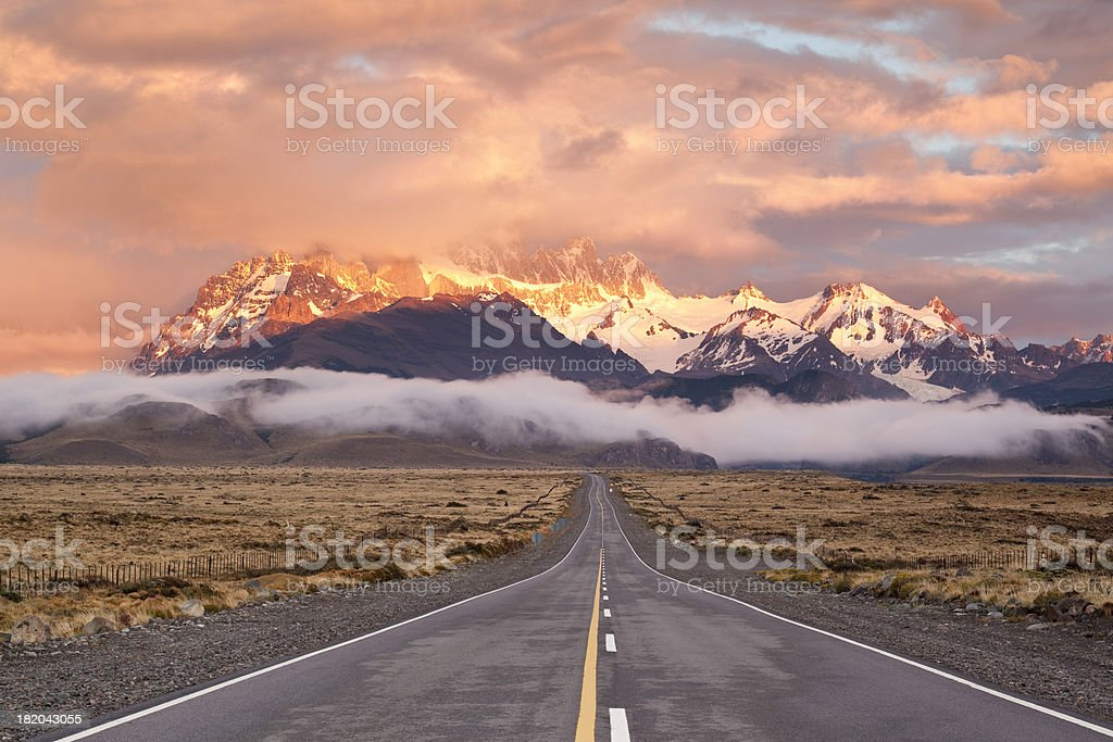 Dramatic sky over empty highway in Argentina Patagonia stock photo