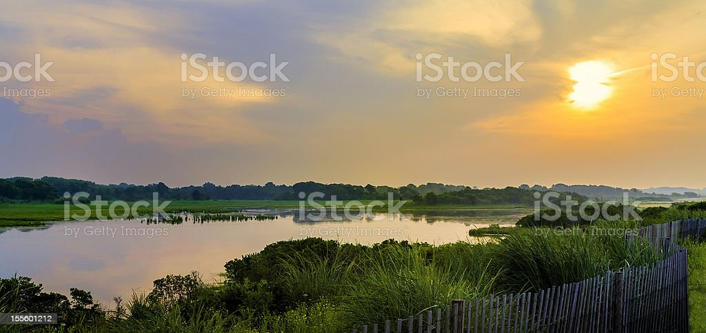 dramatic sky over natural wetlands in New Jersey stock photo