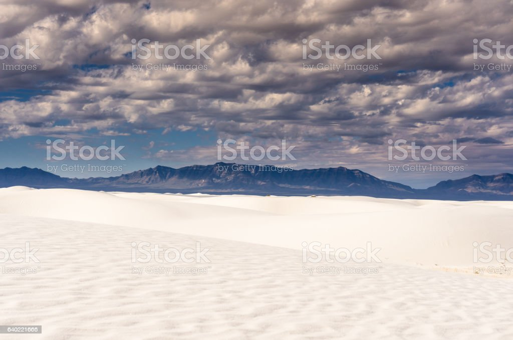 Dramatic Sky Over Pure White Sand Dunes stock photo