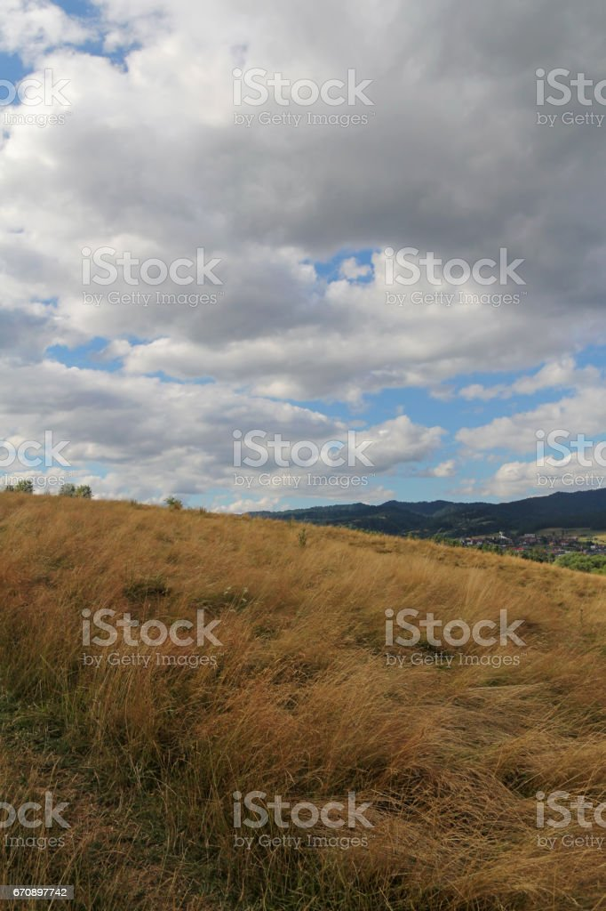 dramatic sky over rural field stock photo