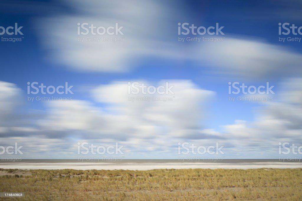 dramatic sky over sand dunes along the Dutch coast royalty-free stock photo