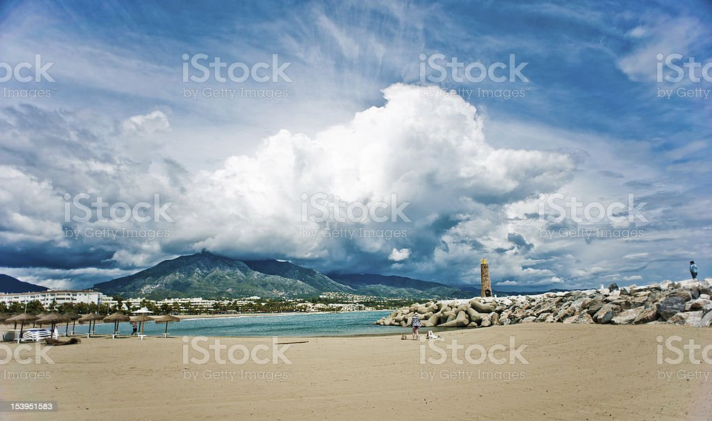 Dramatic sky over Spanish beach stock photo