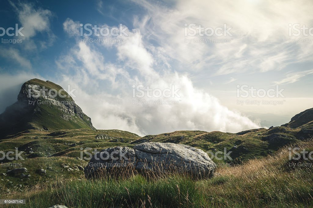 Dramatic sky over valley in mountains stock photo