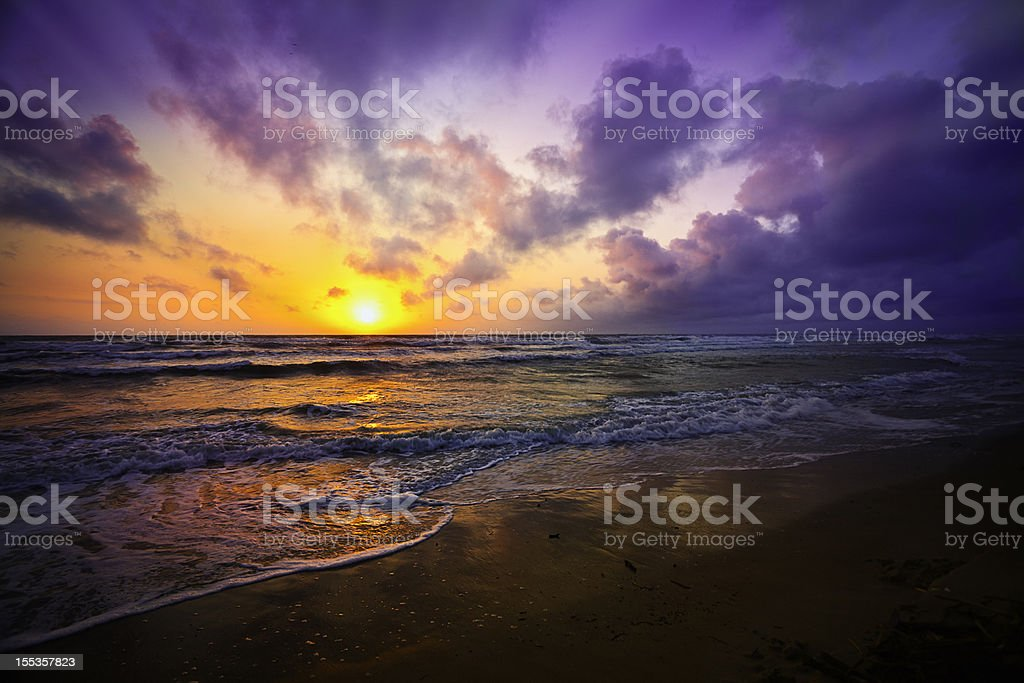 Dramatic sky reflection on a tropical beach at sunrise royalty-free stock photo