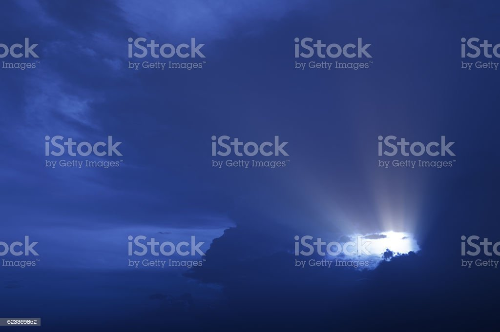 Dramatic sky with light rays stock photo