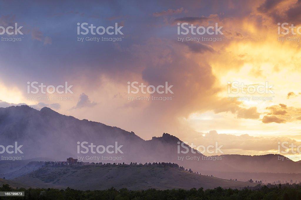 Dramatic Smoke and Fog Mountain Scene stock photo