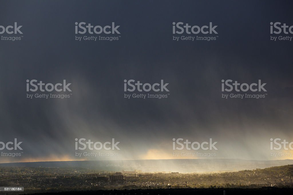 dramatic snow clouds over western paris in spring stock photo