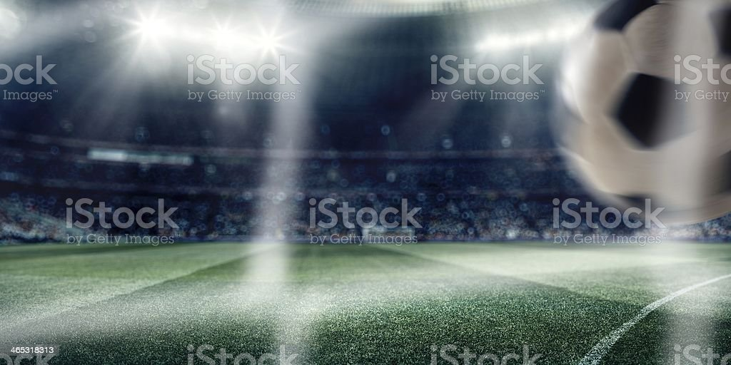 Dramatic soccer stadium with ball stock photo