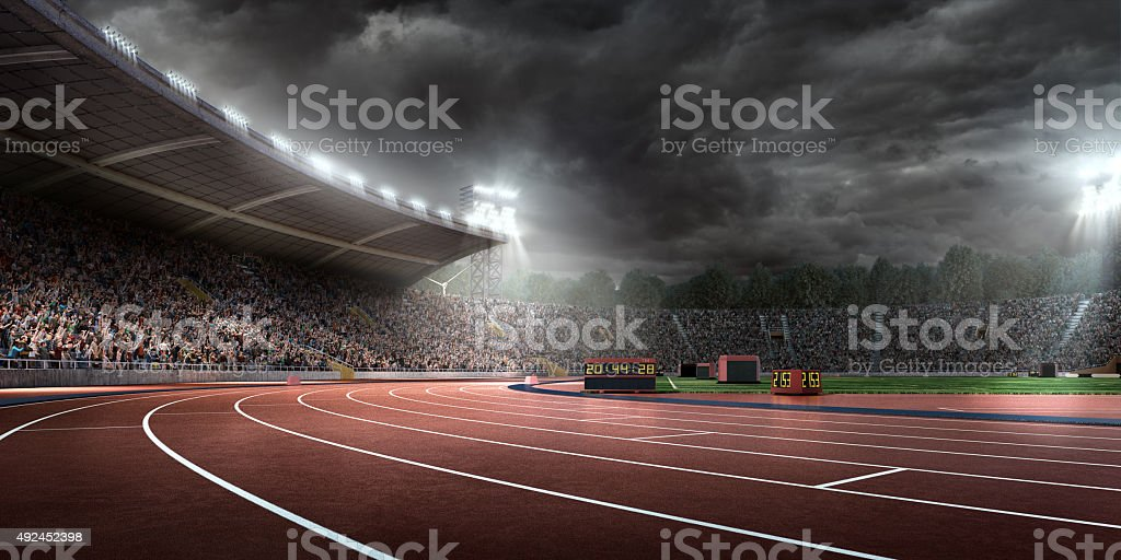 Dramatic olympic stadium with running tracks stock photo