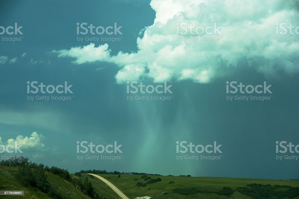Dramatic   storm and surrounding clouds  with hail and rain falling stock photo