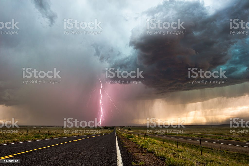 Dramatic storm clouds and lightning stock photo