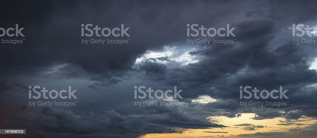 Dramatic storm clouds at sunset royalty-free stock photo