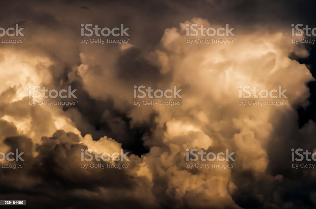 Dramatic Storm Clouds towering high large cumulus clouds sky only stock photo