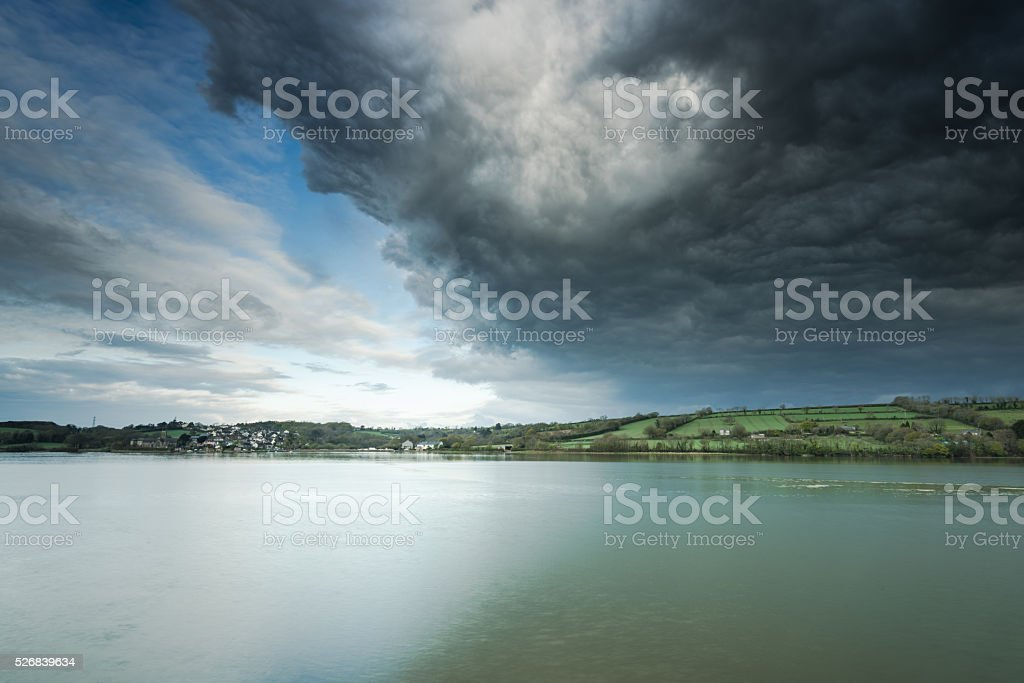 Dramatic storm sky over rivar Tamar estuary,UK stock photo