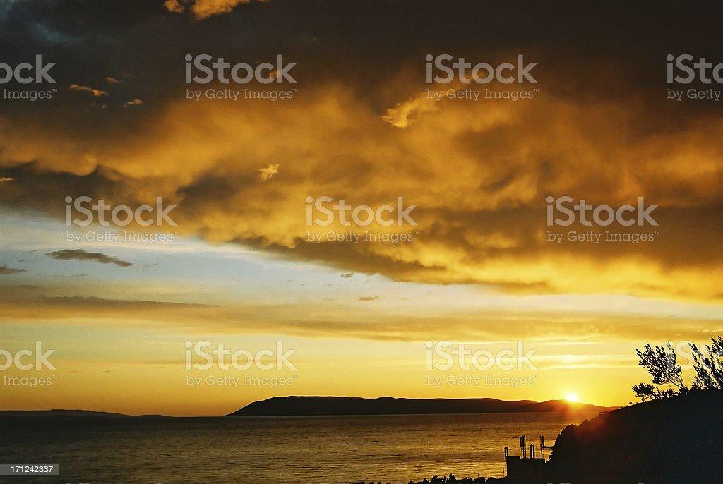 Dramatic storm sunset over sea stock photo