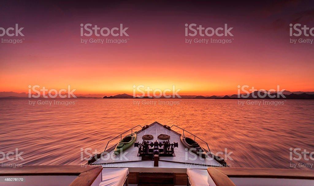 Dramatic sunrise at sea on a luxury yacht stock photo
