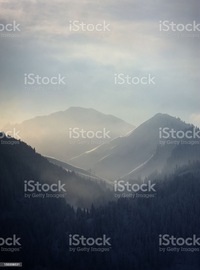 Dramatic sunrise on a cold winter morning, Kleinwalsertal, Austria stock photo