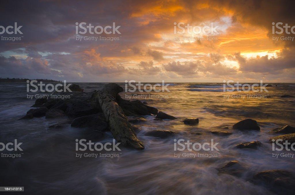 Dramatic sunrise on Kauai, Hawaii beach royalty-free stock photo