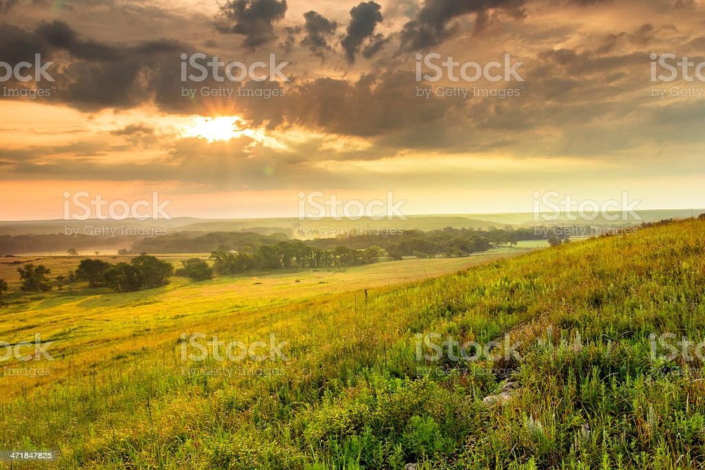 Dramatic Sunrise over the Kansas Tallgrass Prairie Preserve National Park stock photo