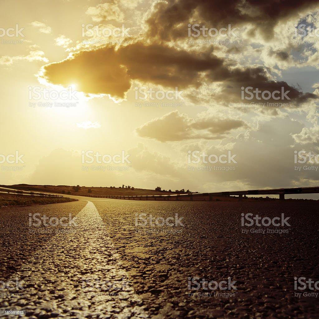 dramatic sunset and asphalt road royalty-free stock photo