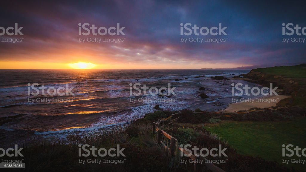 Dramatic sunset at Half Moon Bay beach stock photo