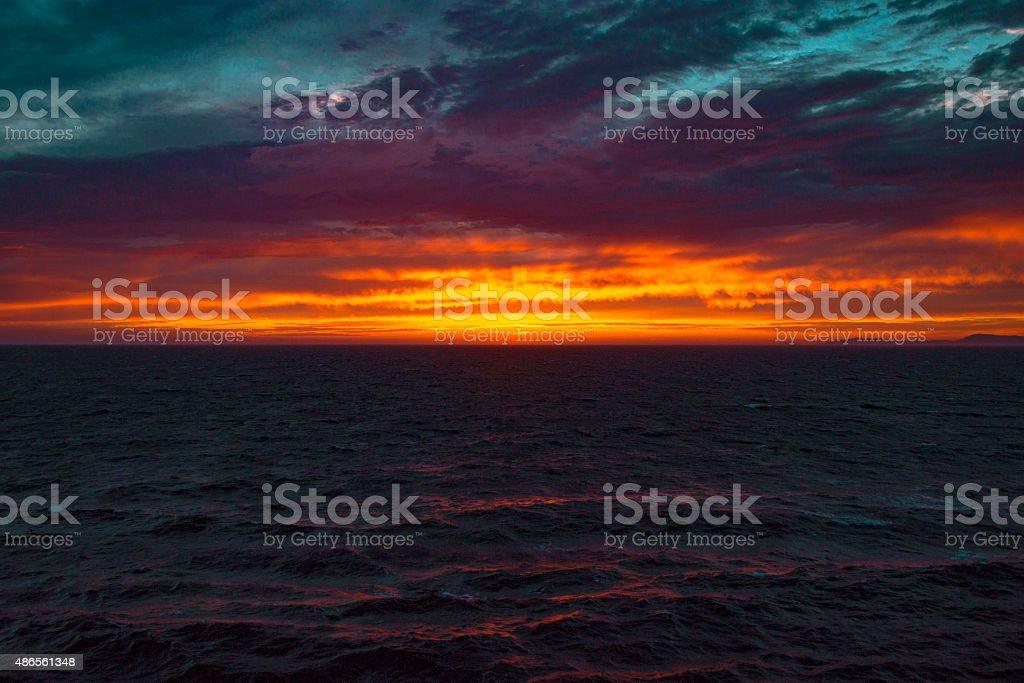 Dramatic sunset at mediterranean sea stock photo