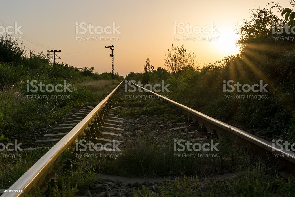 Dramatic sunset at the railway tracks stock photo
