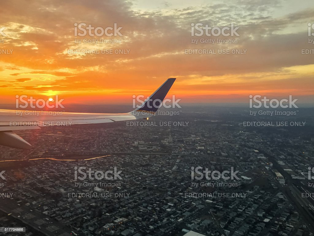 Dramatic sunset from airplane window stock photo
