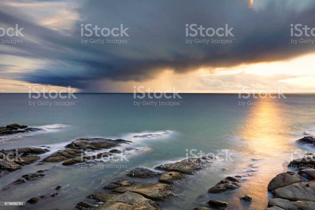 Dramatic sunset in long exposure stock photo