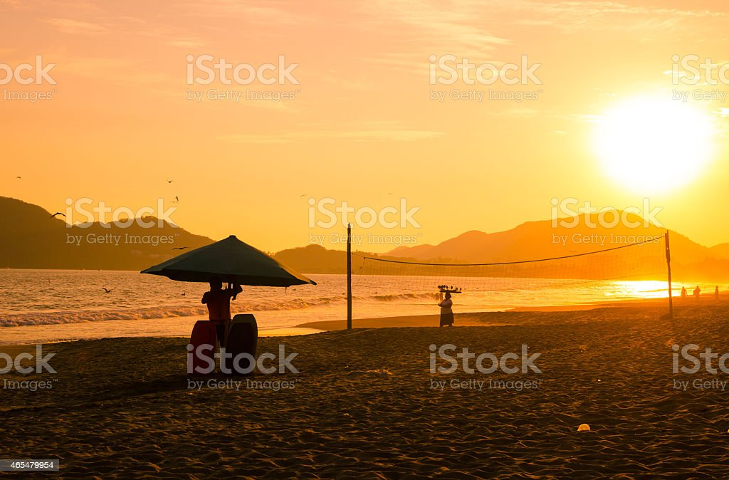 Dramatic sunset on Miramar Beach, Manzanillo, Mexico stock photo