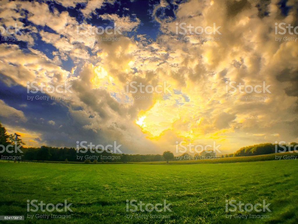 Dramatic sunset over a field stock photo