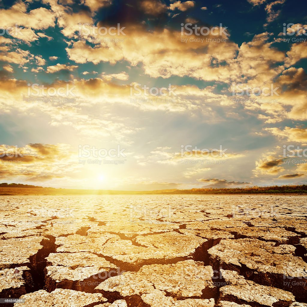 dramatic sunset over drought earth stock photo