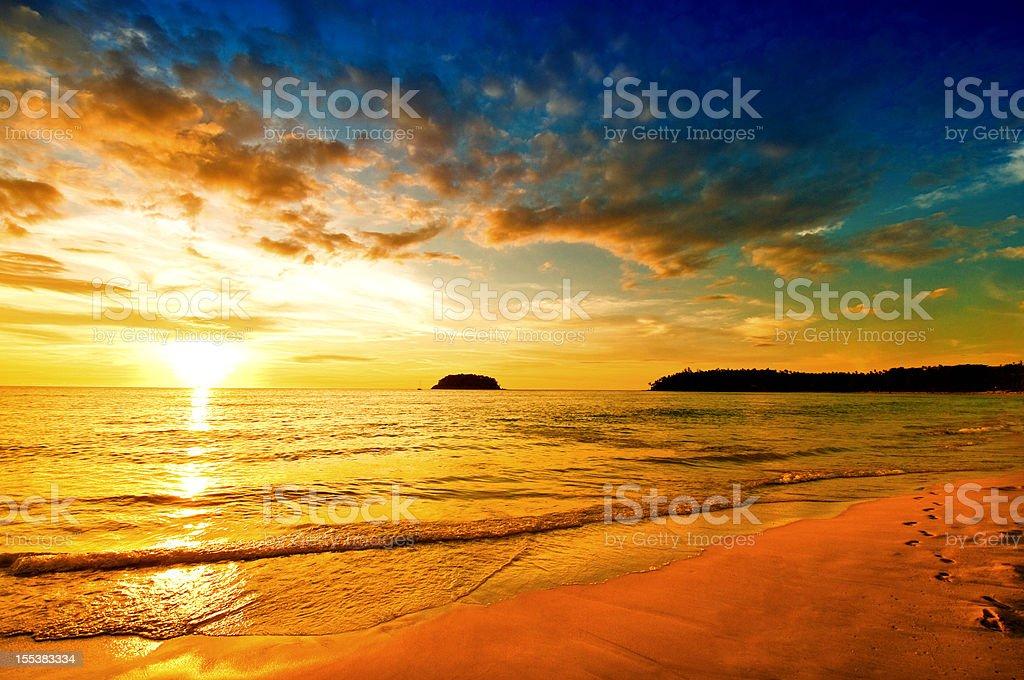 Dramatic Sunset over Empty Beach royalty-free stock photo