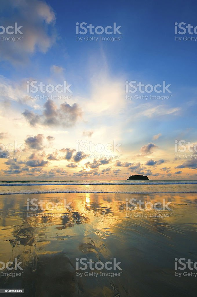 Dramatic Sunset over Empty Beach royalty-free stock photo