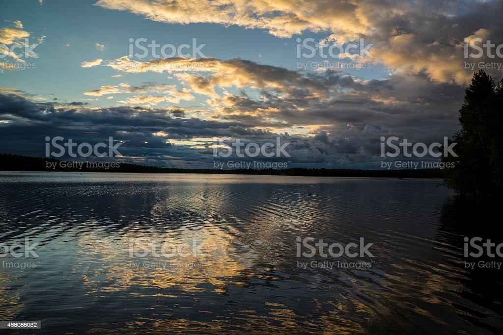 Dramatic sunset over lake stock photo