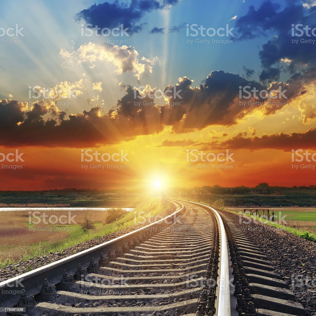dramatic sunset over railroad stock photo