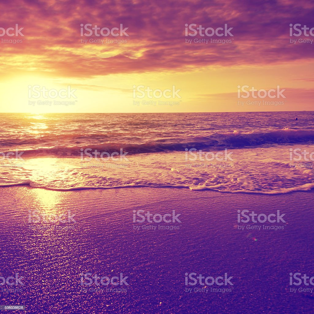 Dramatic sunset over sea and beach. stock photo