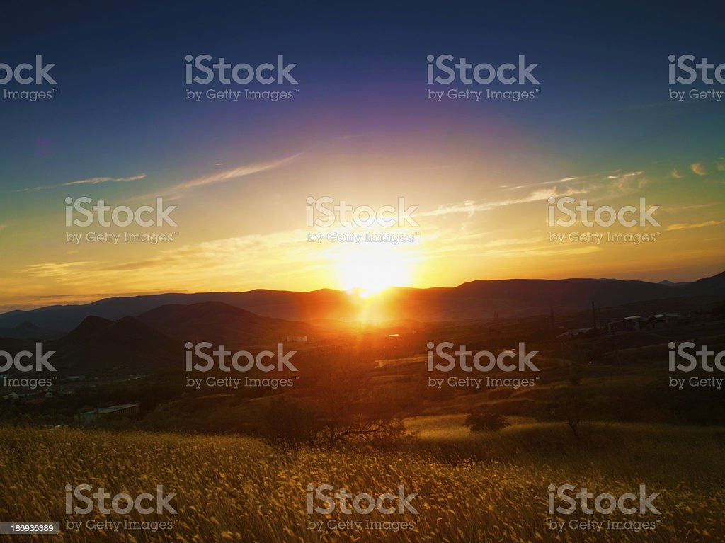 Dramatic sunset over valley. Natural seasonal landscape royalty-free stock photo