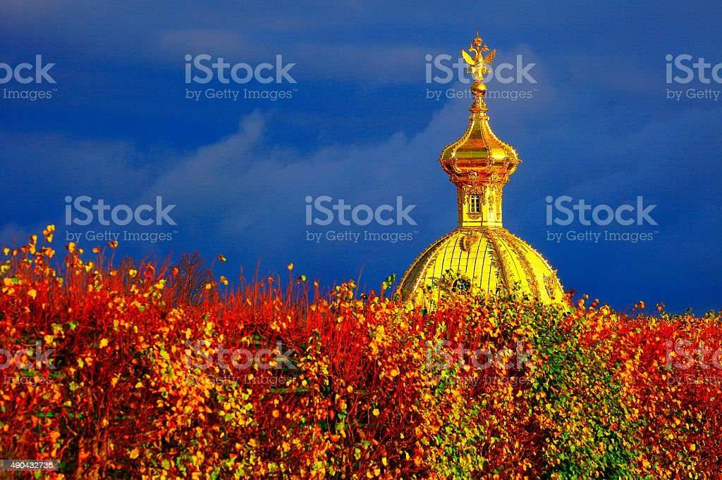 Dramatic sunset, Russian Eagle, Orthodox Church, gold cupola, St. Petersburg stock photo