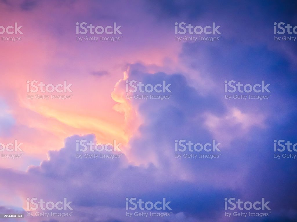 Dramatic Sunset Sky with Varying Coloured Clouds stock photo