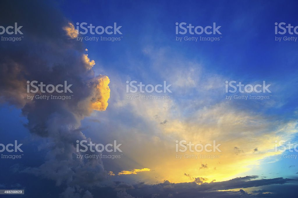 Dramatic sunset sky with yellow, blue and orange thunderstorm cl stock photo