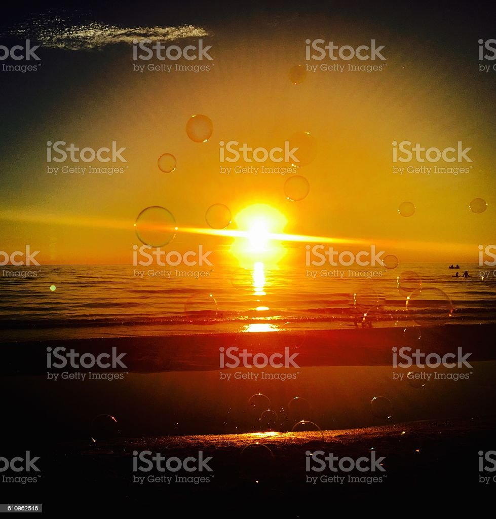Dramatic Sunset with Bubbles stock photo