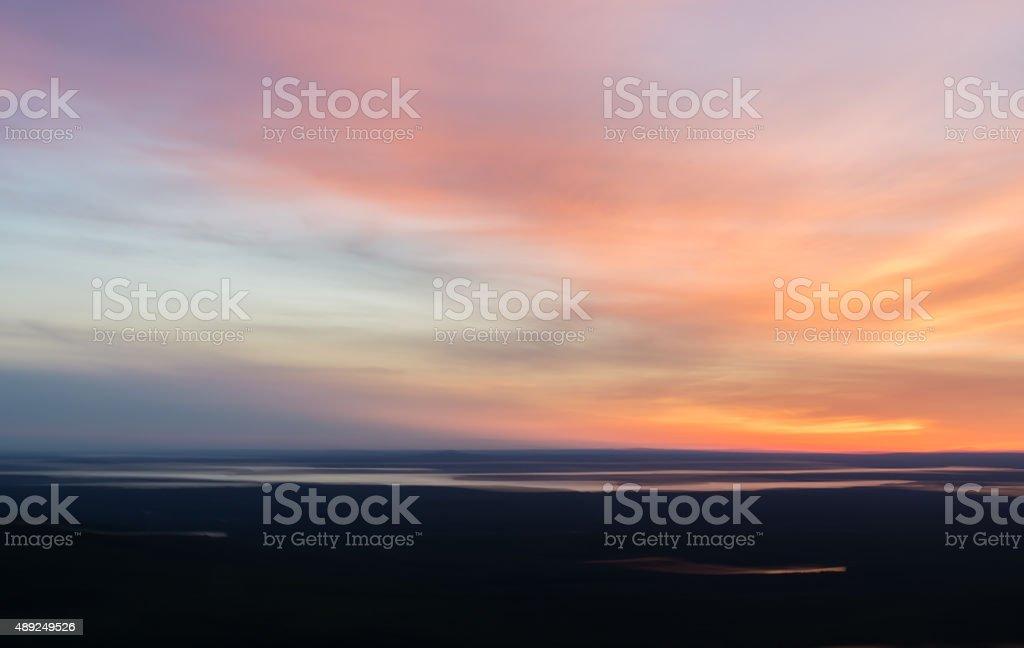 Dramatic Sunset with Dark Landscape stock photo