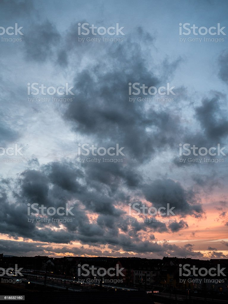 dramatic sunset with scattered clouds stock photo