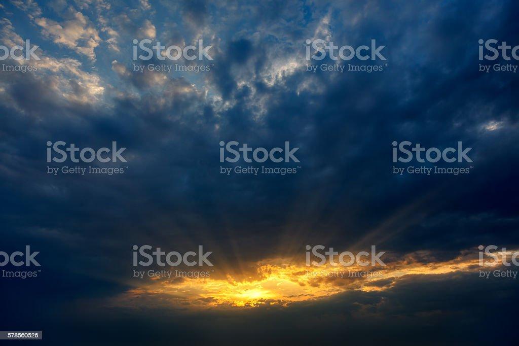 Dramatic sunset with sun rays stock photo